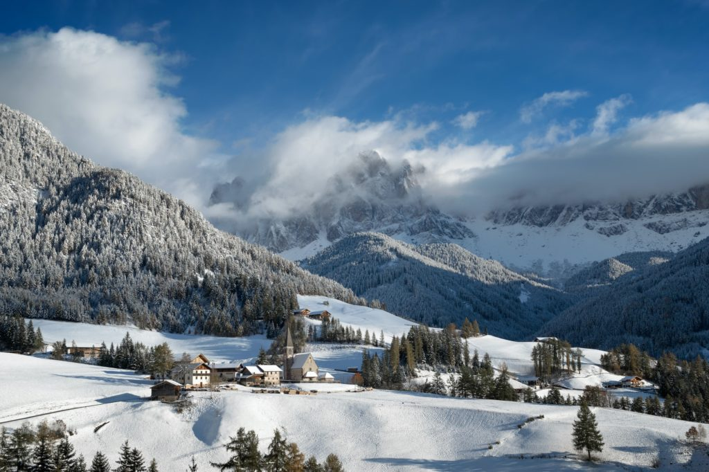 Village and church in the Dolomites in winter